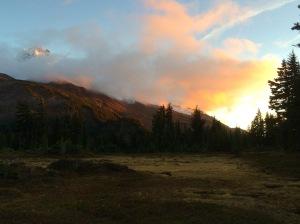 Sunset next to a Mountain